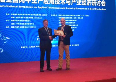 Receiving award @ National Symposium Beef Production - Beijing, China